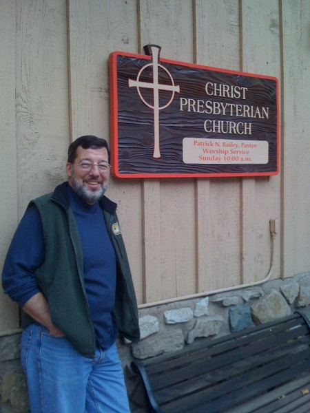 Pastor Pat Bailey in front his church