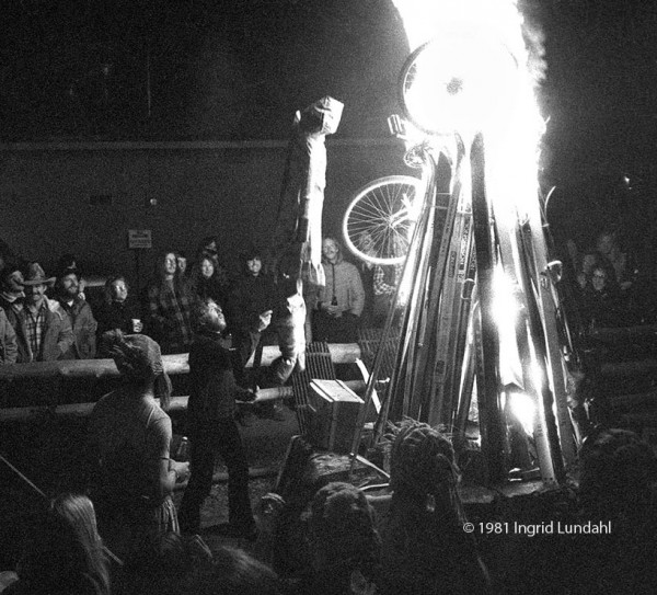 """The Flying Epoxy Sisters host a ski sacrifice on the Old Roma patio in 1981. Here, Edith Epoxy, """"Telluride's only virgin,"""" is being consigned to the flames. The image is featured in Ingrid's Outlaw Book."""